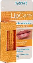 Парфюми, Парфюмерия, козметика Защитен балсам с масло от ший - Floslek Lip Care Protective Lipstick With Shea Butter