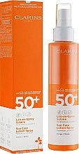 Парфюмерия и Козметика Слънцезащитно спрей мляко за тяло - Clarins Lait-en-Spray Solaire Corps 50+