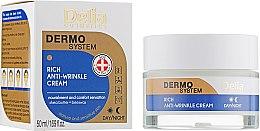 Парфюми, Парфюмерия, козметика Антистареещ подхранващ крем за лице - Delia Dermo System Rich Anti-Wrinkle Cream