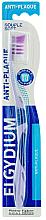 Парфюмерия и Козметика Мека четка за зъби, лилава - Elgydium Anti-Plaque Soft Toothbrush