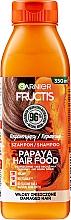 Парфюмерия и Козметика Възстановяващ шампоан за увредена коса с папая - Garnier Fructis Repairing Papaya Hair Food Shampoo