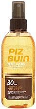Парфюмерия и Козметика Слънцезащитен спрей за тяло - Piz Buin Wet Skin Transparent Sun Spray SPF30