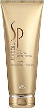 Парфюми, Парфюмерия, козметика Крем-балсам за възстановяване на косата с кератин - Wella SP Luxe Oil Keratin Conditioning Cream