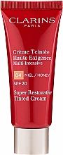 Парфюмерия и Козметика Ревитализиращ тониращ крем за лице - Clarins Super Restorative Tinted Cream SPF 20