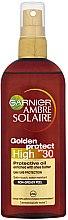 Парфюмерия и Козметика Масло-спрей - Garnier Ambre Solaire Golden Protect SPF30 Oil