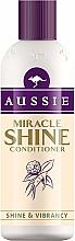 Парфюмерия и Козметика Балсам за изтощена и увредена коса - Aussie Miracle Shine Conditioner